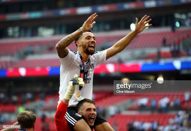 Ryan Fredericks of Fulham celebrates with Marcus Bettinelli of Fulham following their sides victory in the Sky Bet Championship Play Off Final...