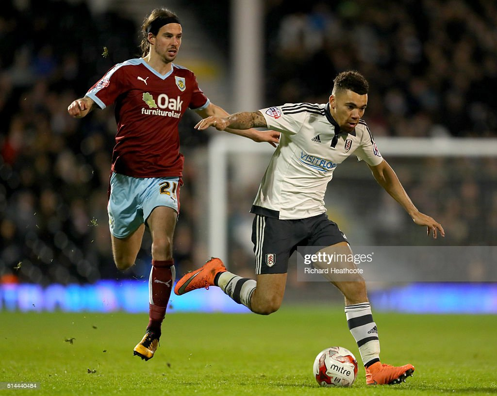 Ryan Fredericks of Fulham holds off George Boyd of Burnley during the Sky Bet Championship match between Fulham and Burnley at Craven Cottage on March 8, 2016 in London, United Kingdom.