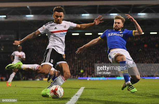 Ryan Fredericks of Fulham is challenged by Charlie Taylor of Leeds United during the Sky Bet Championship match between Fulham and Leeds United at...
