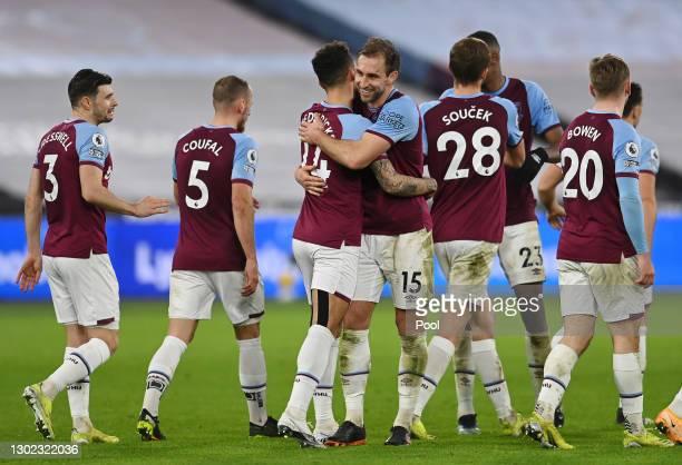 Ryan Fredericks of West Ham celebrates with teammate Craig Dawson after scoring their team's third goal during the Premier League match between West...