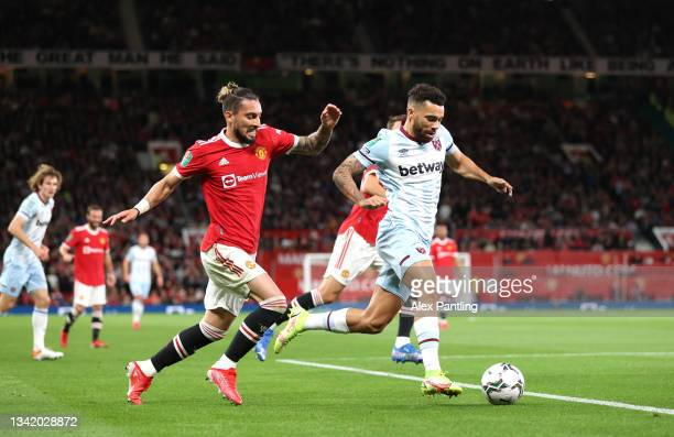 Ryan Fredericks of West Ham takes on Alex Telles of Manchester United during the Carabao Cup Third Round match between Manchester United and West Ham...