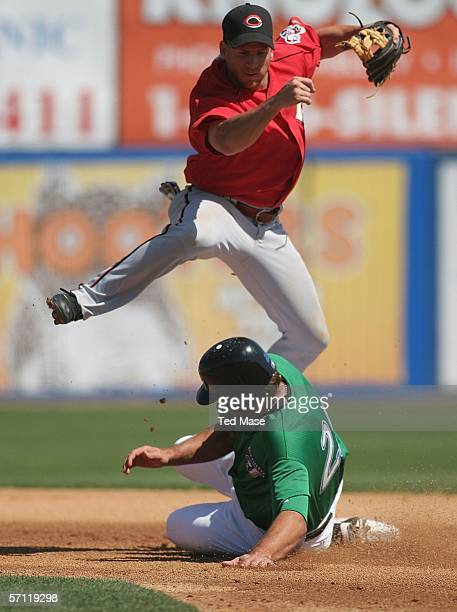 Ryan Freel of the Cincinnati Reds turns a double play as Troy Glaus of the Toronto Blue Jays is out sliding into second base during their Spring...