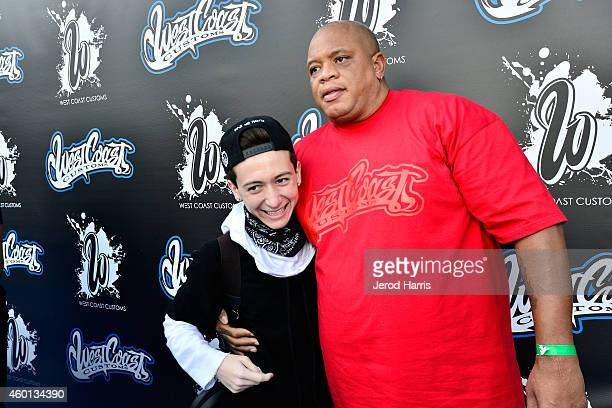 Ryan Friedlinghaus Jr and Big Dane attend the Grand Opening of West Coast Customs Burbank Headquarters on December 7 2014 in Burbank California