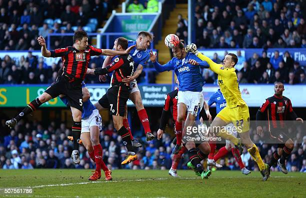 Ryan Fulton and Christian Burgess of Portsmouth clear the danger during the Emirates FA Cup Fourth Round match between Portsmouth and AFC Bournemouth...