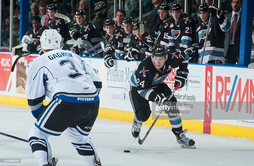 Ryan Gagnon #3 of Victoria Royals forechecks Tyson Baillie #24 of Kelowna Rockets on OCTOBER 9, 2015 at Prospera Place in Kelowna, British Columbia, Canada.