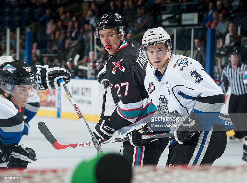 Ryan Gagnon #3 of Victoria Royals stick checks Calvin Thurkauf #27 of Kelowna Rockets on OCTOBER 9, 2015 at Prospera Place in Kelowna, British Columbia, Canada.