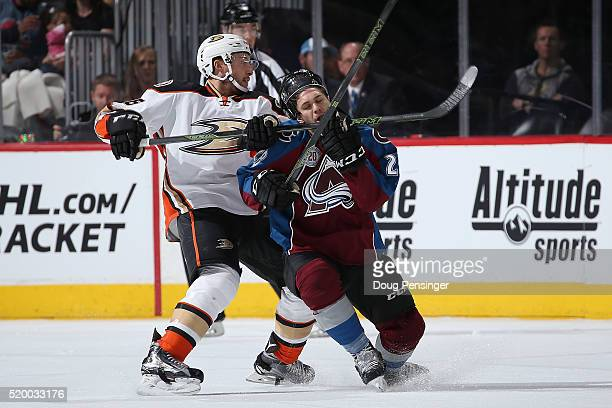 Ryan Garbutt of the Anaheim Ducks draws penalties for highsticking and unsportsmanlike conduct on this play against Andrew Agozzino of the Colorado...