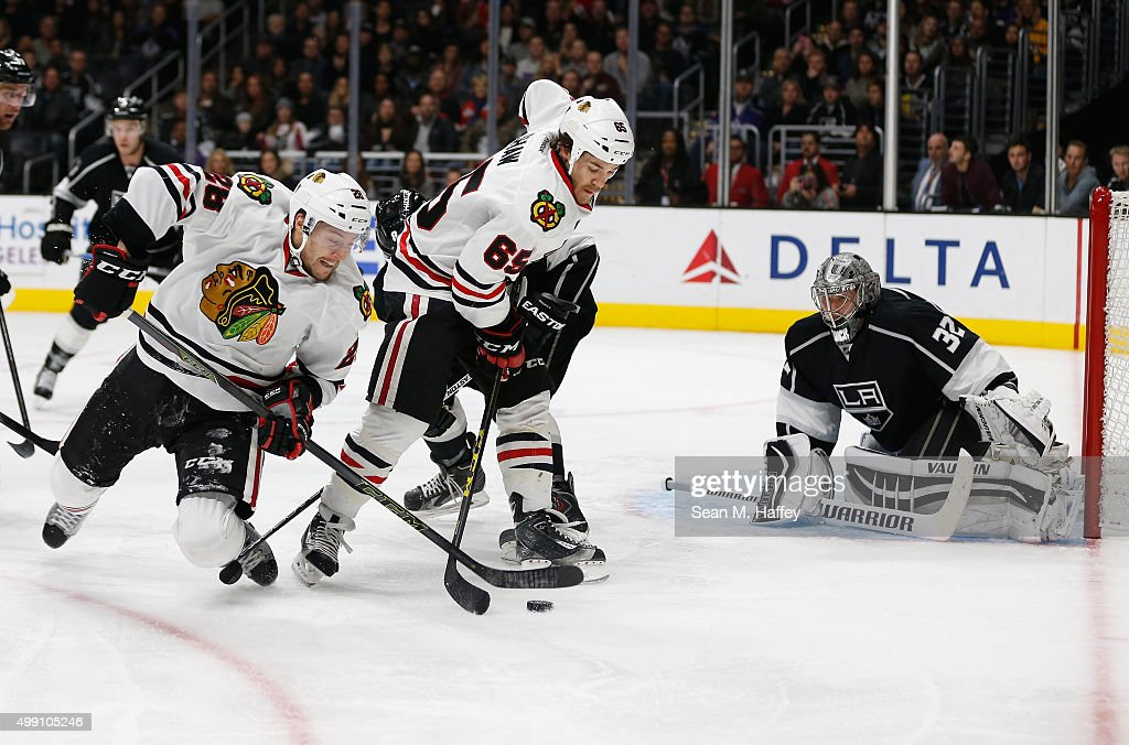 Ryan Garbutt #28 of the Chicago Blackhawks, Andrew Shaw #65 of the Chicago Blackhawks struggle for the puck as Jonathan Quick #32 of the Los Angeles Kings defends the net during the third period of a game at Staples Center on November 28, 2015 in Los Angeles, California.
