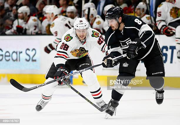 Ryan Garbutt of the Chicago Blackhawks defends against Drew Doughty of the Los Angeles Kings during a game at Staples Center on November 28 2015 in...
