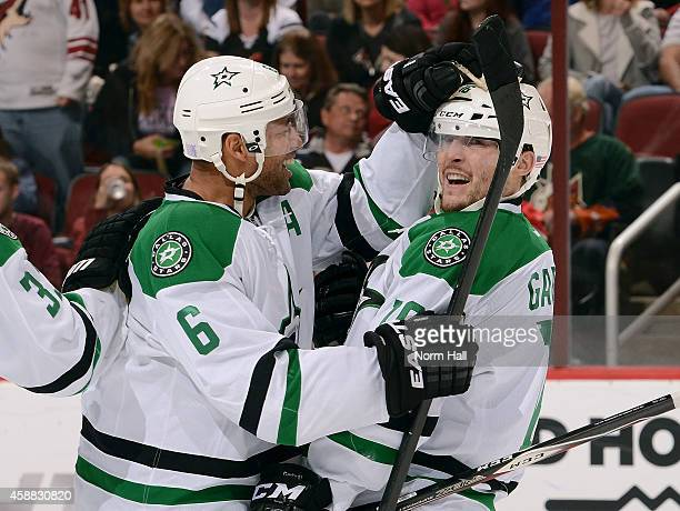 Ryan Garbutt of the Dallas Stars celebrates with teammate Trevor Daley after his third period goal against the Arizona Coyotes at Gila River Arena on...