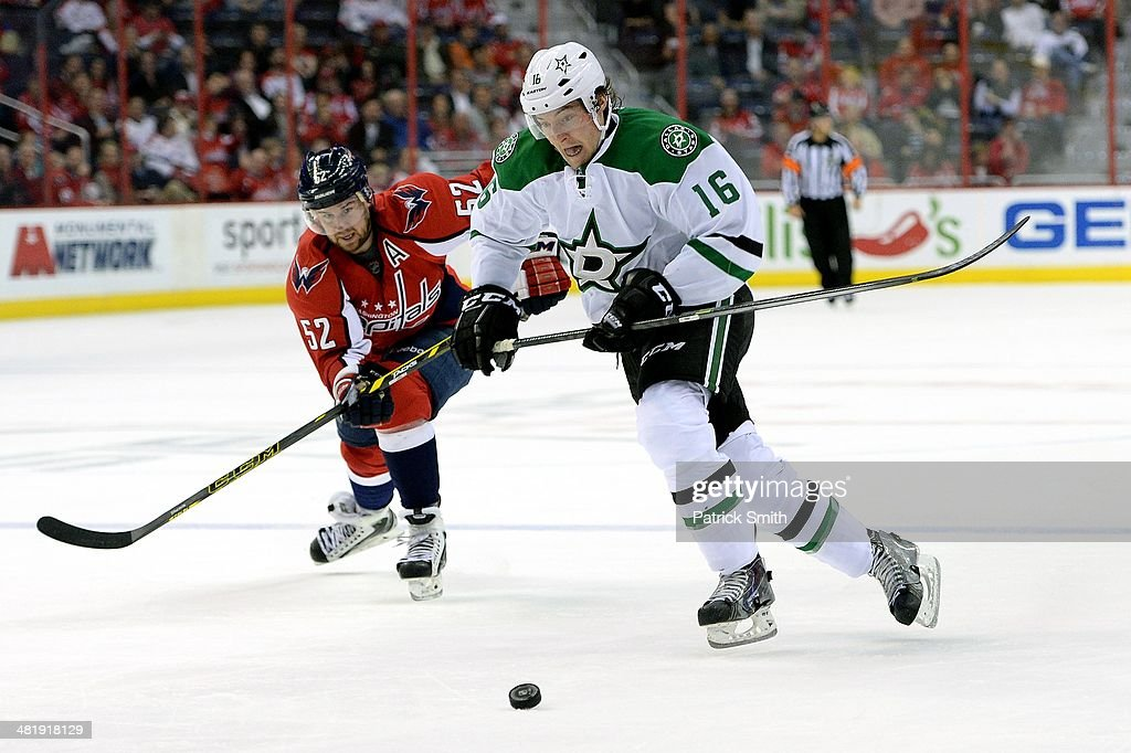 Ryan Garbutt #16 of the Dallas Stars skates past Mike Green #52 of the Washington Capitals before scoring a shorthanded goal in the third period during an NHL game at Verizon Center on April 1, 2014 in Washington, DC.