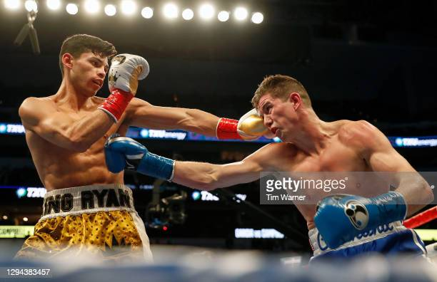 Ryan Garcia and Luke Campbell exchange punches during the WBC Interim Lightweight Title fight at American Airlines Center on January 02, 2021 in...
