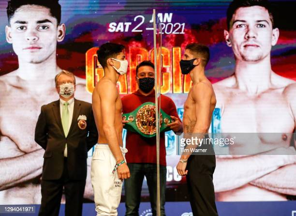 Ryan Garcia and Luke Campbell face off duing the weigh in ahead of their WBC interim lightweight title fight at American Airlines Arena on January...