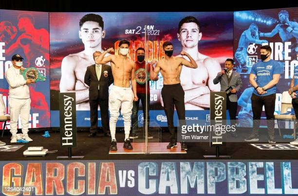 Ryan Garcia and Luke Campbell pose during the weigh in ahead of the WBC interim lightweight title fight at American Airlines Arena on January 01,...