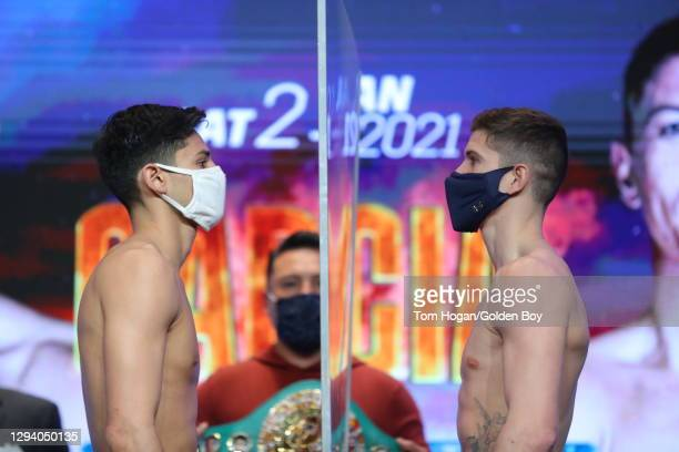 Ryan Garcia and Luke Campbell pose on stage for the weigh in ahead of the WBC interim lightweight title fight at American Airlines Center on January...