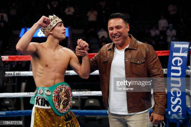 Ryan Garcia is congratulated by Oscar De La Hoya after the WBC Interim Lightweight Title fight against Luke Campbell at American Airlines Center on...