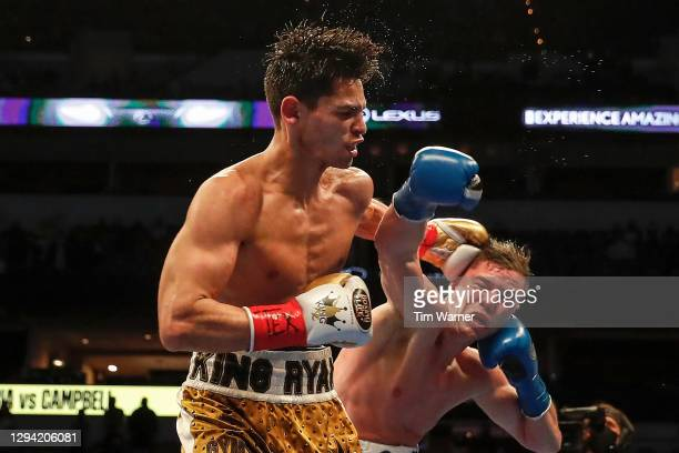 Ryan Garcia lands a left hook against Luke Campbell during the WBC Interim Lightweight Title fight at American Airlines Center on January 02, 2021 in...