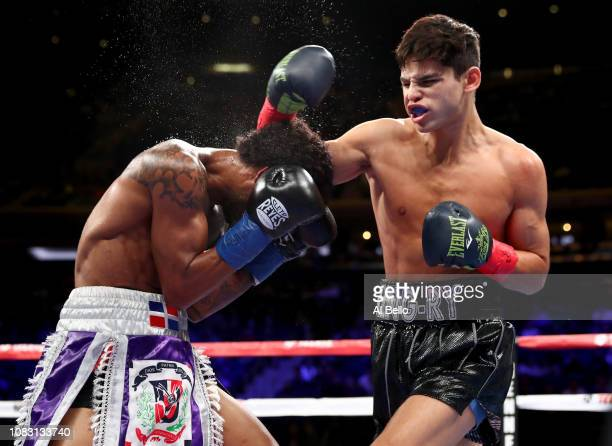 Ryan Garcia lands a punch against Braulio Rodriguez during their Super Featherweight bout at Madison Square Garden on December 15 2018 in New York...