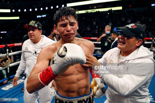 Ryan Garcia reacts after knocking out Luke Campbell during the WBC Interim Lightweight Title fight at American Airlines Center on January 02, 2021 in...