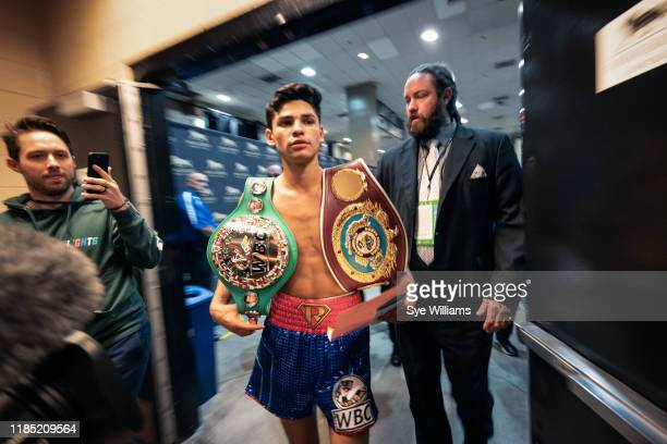 Ryan Garcia walks back to dressing rom with belts after defeating Romero Duno by knockout at the 1:38 mark of the first round of their fight at the...