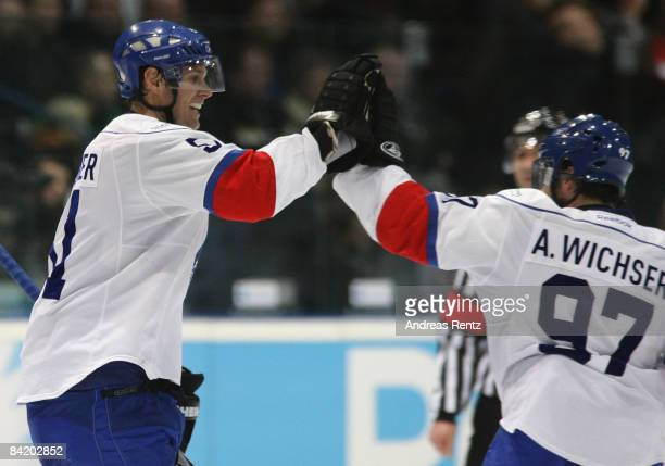 Ryan Gardner and Adrian Wichser of Lions Zurich celebrate after fifth goal during the IIHF Champions Hockey League semi-final match between Espoo...