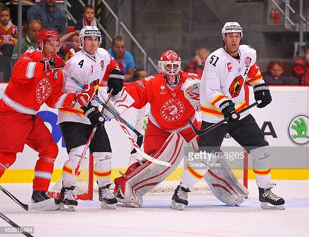 Ryan Gardner and Bud Holloway of SC Bern and Simon Hrubec and Tomas Plihal of HC Ocelari Trinec during the Champions Hockey League group stage game...