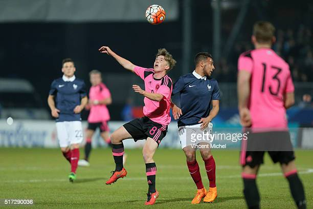 Ryan Gauld of Scotland and Corentin Tolisso of France during the Uefa U21 European Championship qualifier between France and Scotland at Stade Jean...