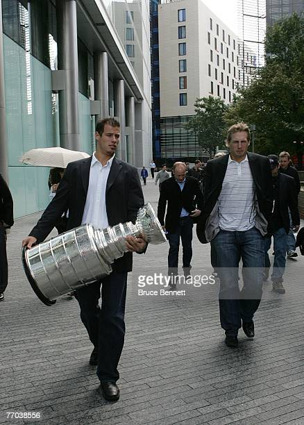 Ryan Getzlaf and Corey Perry of the Anaheim Ducks along with the Stanley Cup tour London on September 26 2007 prior to this weekend's games against...
