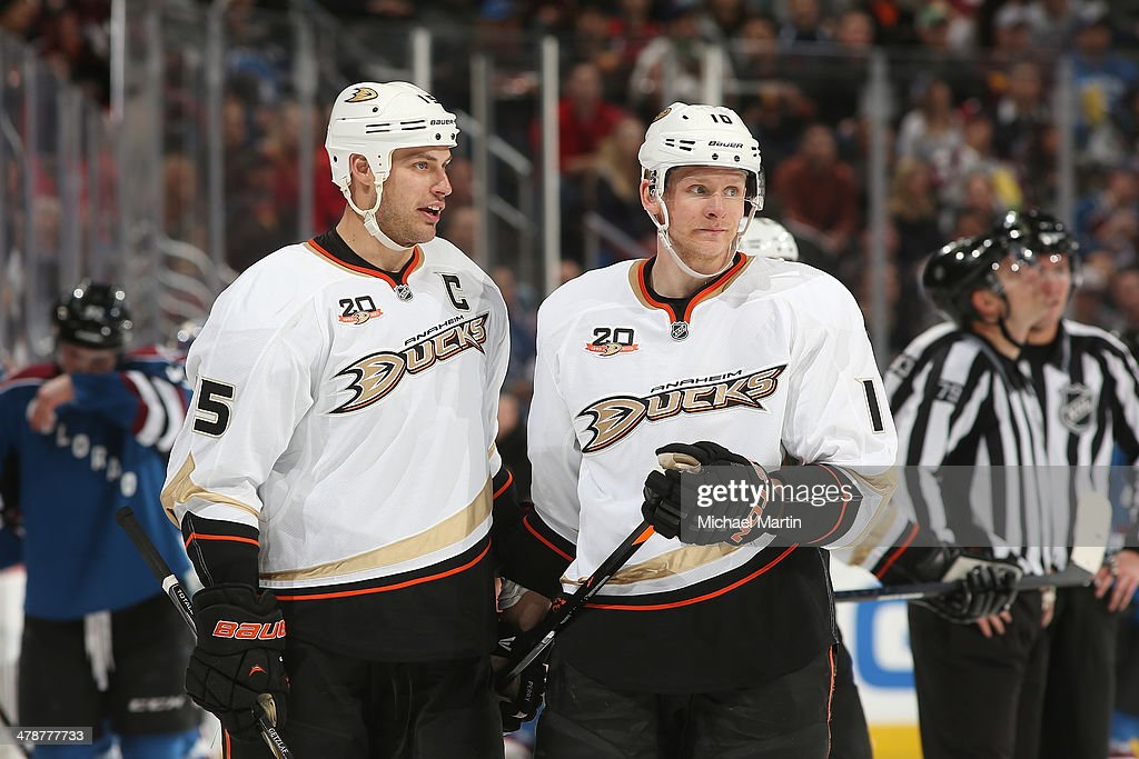 Ryan Getzlaf #15 and Corey Perry #10 of the Anaheim Ducks talk during a break in the action against the Colorado Avalanche at the Pepsi Center on March 14, 2014 in Denver, Colorado.