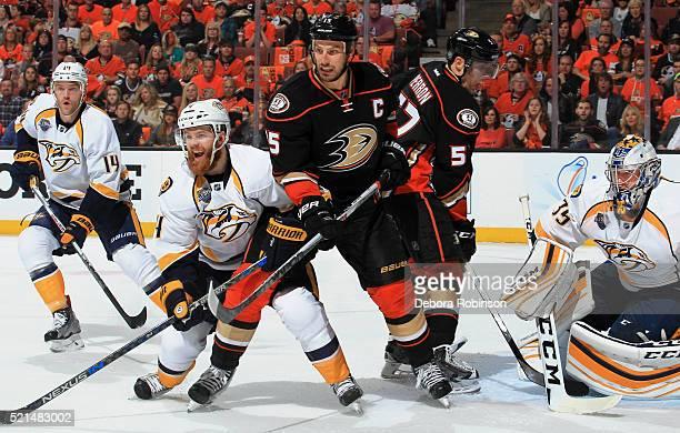 Ryan Getzlaf and Korbinian Holzer of the Anaheim Ducks battle for position against Ryan Ellis Mattias Ekholm and Pekka Rinne of the Nashville...