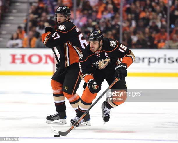 Ryan Getzlaf and Rickard Rakell of the Anaheim Ducks start a play during the first period against the Calgary Flames in Game One of the Western...