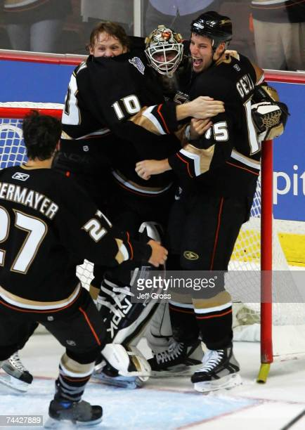 Ryan Getzlaf, Corey Perry and goaltender Jean-Sebastien Giguere of the Anaheim Ducks celebrate after defeating the Ottawa Senators in Game Five of...