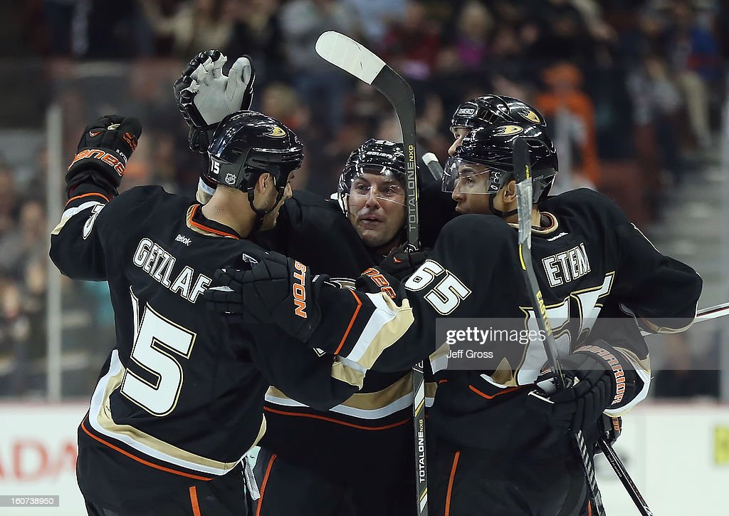 Ryan Getzlaf #15, Francois Beauchemin #23, Sheldon Souray #44 and Emerson Etem #65 of the Anaheim Ducks celebrate Souray's third period goal against the San Jose Sharks at Honda Center on February 4, 2013 in Anaheim, California. The Ducks defeated the Sharks 2-1.
