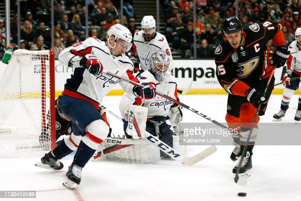 Ryan Getzlaf of the Anaheim Ducks and Dmitry Orlov of the Washington Capitals fight for control of the puck during the third period at Honda Center...