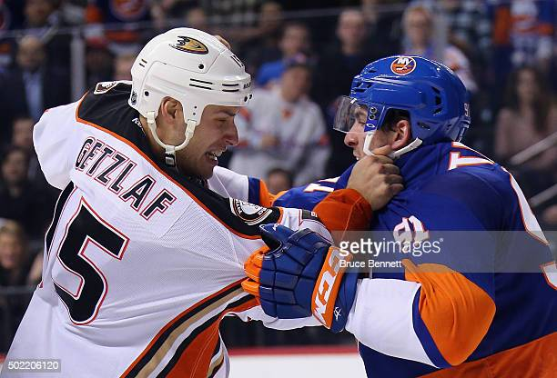 Ryan Getzlaf of the Anaheim Ducks and John Tavares of the New York Islanders exchange pushes during the second period at the Barclays Center on...