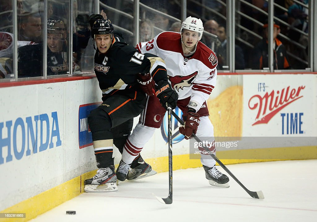 Ryan Getzlaf #15 of the Anaheim Ducks and Oliver Ekman-Larsson #23 of the Phoenix Coyotes fight for the puck in the third period at Honda Center on March 6, 2013 in Anaheim, California. The Ducks defeated the Coyotes 2-0.