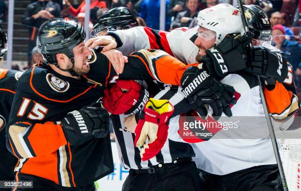 Ryan Getzlaf of the Anaheim Ducks and Patrick Maroon of the New Jersey Devils fight during the third period of the game at Honda Center on March 18...