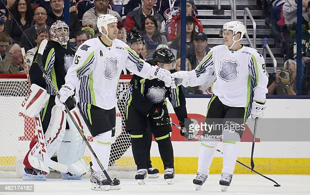 Ryan Getzlaf of the Anaheim Ducks and Team Toews and Vladimir Tarasenko of the St. Louis Blues and Team Toews celebrate against Team Foligno in the...