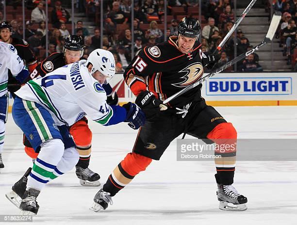 Ryan Getzlaf of the Anaheim Ducks battles for position against Matt Bartkowski of the Vancouver Canucks on April 1, 2016 at Honda Center in Anaheim,...