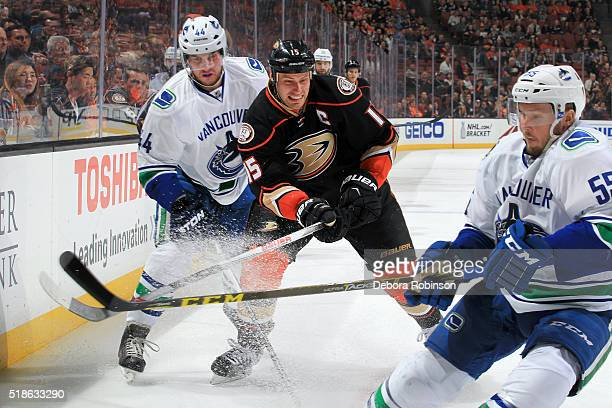 Ryan Getzlaf of the Anaheim Ducks battles for position against Matt Bartkowski and Alex Biega of the Vancouver Canucks on April 1, 2016 at Honda...