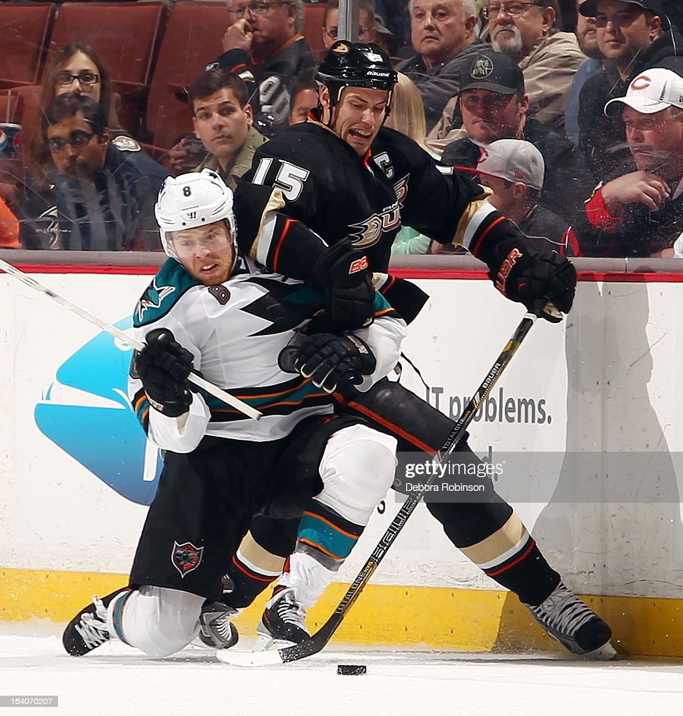 Ryan Getzlaf #15 of the Anaheim Ducks battles for the puck against Joe Pavelski #8 of the San Jose Sharks on March 18, 2013 at Honda Center in Anaheim, California.