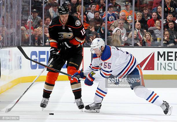 Ryan Getzlaf of the Anaheim Ducks battles for the puck against Mark Letestu of the Edmonton Oilers on February 26 2016 at Honda Center in Anaheim...