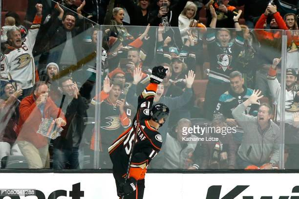 Ryan Getzlaf of the Anaheim Ducks celebrates his gamewinning goal following a shootout against the New Jersey Devils at Honda Center on December 09...