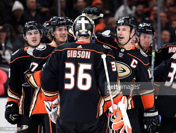 Ryan Getzlaf of the Anaheim Ducks celebrates his overtime goal with John Gibson for a 21 win over the Vancouver Canucks at Honda Center on November...