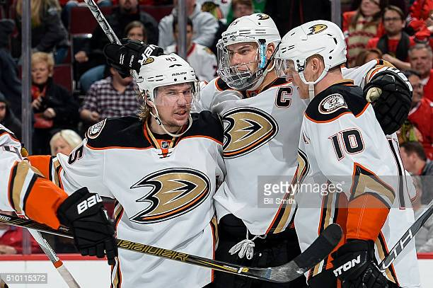 Ryan Getzlaf of the Anaheim Ducks celebrates with Sami Vatanen and Corey Perry after scoring the game winning goal in overtime, resulting in a 3 to 2...