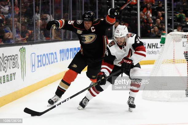 Ryan Getzlaf of the Anaheim Ducks chases Robbie Russo during the third period of an NHL preseason game at Honda Center on September 24 2018 in...