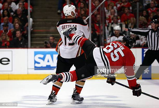 Ryan Getzlaf of the Anaheim Ducks checks Andrew Shaw of the Chicago Blackhawks in the third period of Game Four of the Western Conference Finals...