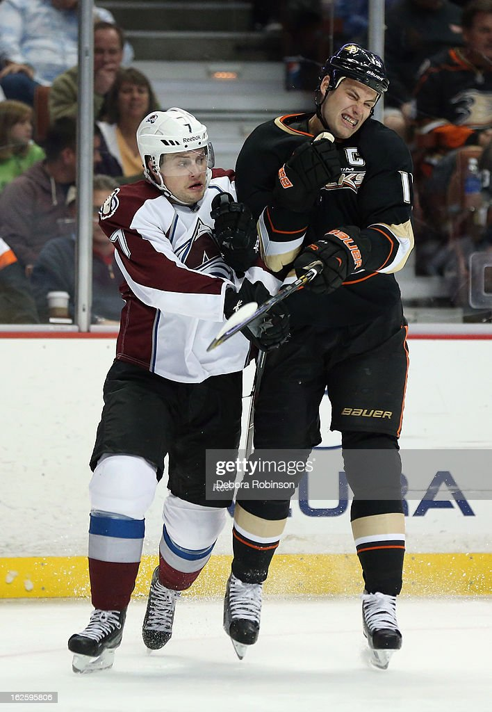 Ryan Getzlaf #15 of the Anaheim Ducks checks John Mitchell #7 of the Colorado Avalanche in the third period at Honda Center on February 24, 2013 in Anaheim, California. The Ducks defeated the Avalanche 4-3 in overtime.