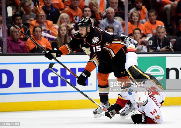 Ryan Getzlaf of the Anaheim Ducks checks Mark Giordano to the ice during a 32 Ducks win in Game One of the Western Conference First Round during the...