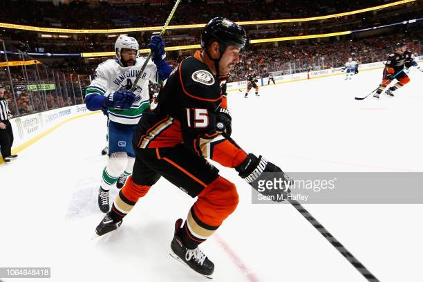 Ryan Getzlaf of the Anaheim Ducks eludes Darren Archibald of the Vancouver Canucks during the third period of a game at Honda Center on November 21...